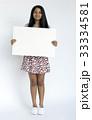 Woman standing doing photoshoot in studio 33334581