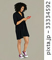 African descent woman using phone 33334592