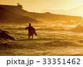 Bodyboarder walkimg at sunrise 33351462