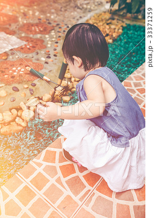 Asian child holding shovel prepared to gardening. 33371259