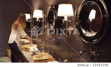 Elegant Lady Wash Hand In Luxurious Bathroom 33425246
