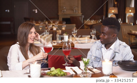 Young couple on date in restaurant. 33425257