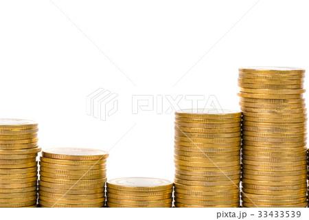 Columns piles of coins on white backgroundの写真素材 [33433539] - PIXTA