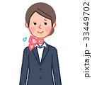 スーツ&スカーフ 女性 正面 困った笑顔 33449702