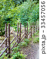 Fence of wooden poles 33457056