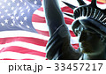 Flag of usa waving on rising sun with statue of 33457217