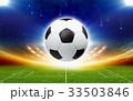 Soccer ball above green football stadium at night 33503846