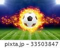 Burning soccer ball above green football stadium 33503847