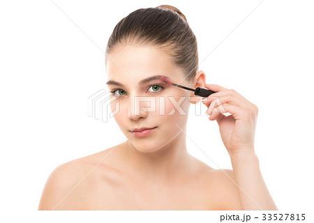 Eye make up apply. Mascara applying closeup, long 33527815
