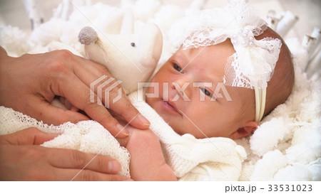 Mom And Her Tiny Newborn Baby's. Happy Family 33531023
