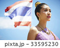 A portrait of beautiful Thai woman standing seriously in the morning. 33595230