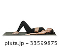 Woman exercising on yoga mat. Isolated on white. 33599875