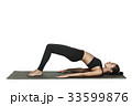 Woman exercising on yoga mat. Isolated on white. 33599876