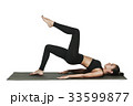 Woman exercising on yoga mat. Isolated on white. 33599877