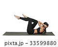 Woman exercising on yoga mat. Isolated on white. 33599880