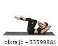 Woman exercising on yoga mat. Isolated on white. 33599881