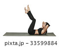 Woman exercising on yoga mat. Isolated on white. 33599884