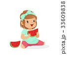 Sweet little girl enjoying eating watermelon 33609838