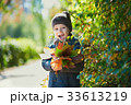 Happy child, boy, playing in the park, throwing 33613219