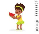 Sweet little african girl enjoying eating 33638697