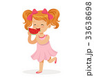 Sweet little redhead girl enjoying eating 33638698