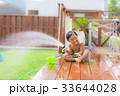 ウッドデッキ 男の子 水遊びの写真 33644028