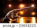Young man dancing 33658225