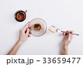 Woman eating cake and drinking tea 33659477