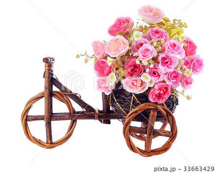 pink roses flowers in a decorative wooden bicycleの写真素材 [33663429] - PIXTA