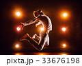 Young man jumping 33676198