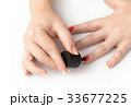 nail painting with red lacquer 33677225