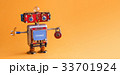 Friendly robot toy with key padlock on orange 33701924
