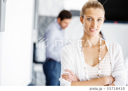Attractive female worker in office 33718410