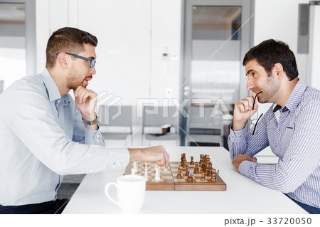 Portrait of two young man playing chess 33720050