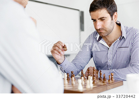 Portrait of two young man playing chess 33720442