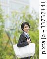 ワーキングマザー ビジネスウーマン 笑顔の写真 33732141