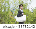 ワーキングマザー ビジネスウーマン 笑顔の写真 33732142
