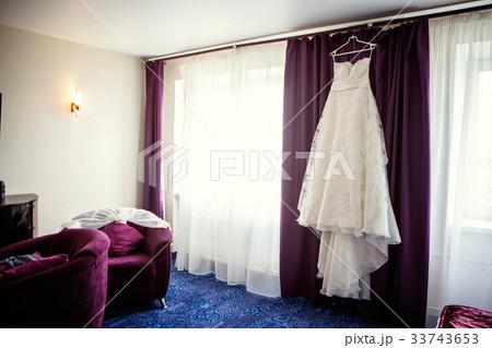 Wedding Dress Hanging in a Windowの写真素材 [33743653] - PIXTA