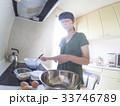 家庭での調理シーン(動きのある表現) 33746789