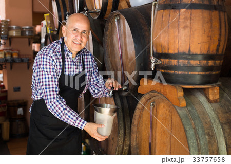 man holding wine in wine house 33757658