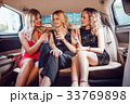 Pretty women having party in a limousine car and 33769898