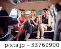 Pretty women having party in a limousine car and 33769900