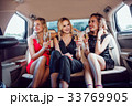 Pretty women having party in a limousine car and 33769905