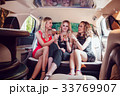 Pretty women having party in a limousine car and 33769907