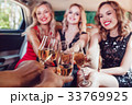 Pretty women having party in a limousine car and 33769925