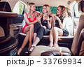 Pretty women having party in a limousine car and 33769934