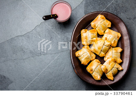 Mini chilean empanadas on clay plate with typical 33790461