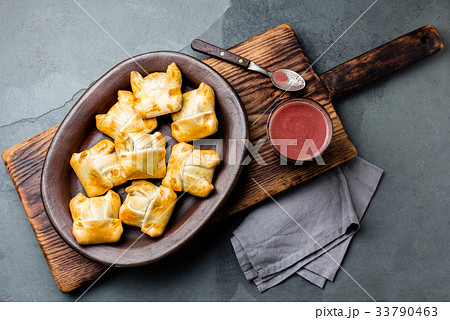 Mini chilean empanadas on clay plate with typical 33790463