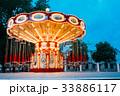 Brightly Illuminated Empty Carousel Merry-Go-Round 33886117