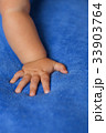 Child's hand on the veil 33903764